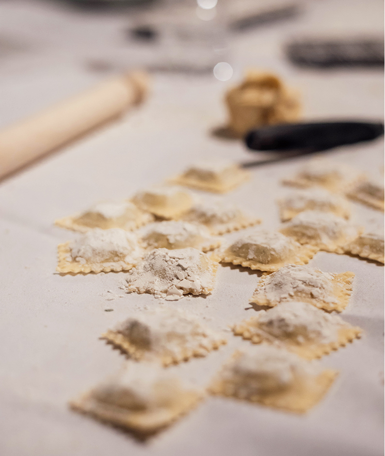 Learn to make pasta, ravoli pasta strewn across a counter