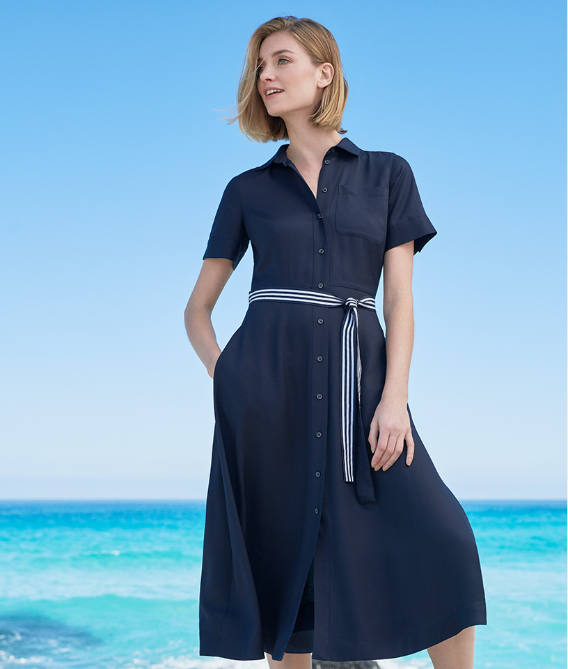 Navy shirt dress with white and navy striped belt on the beach