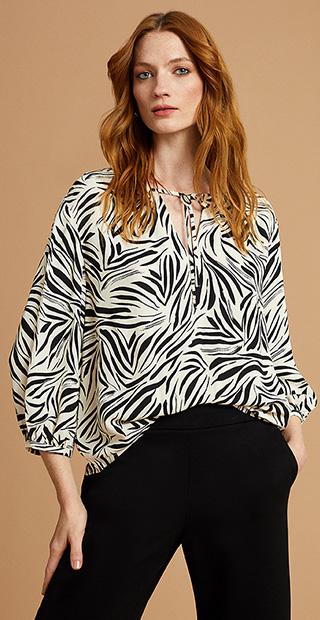 White and Black Animal Print Blouse