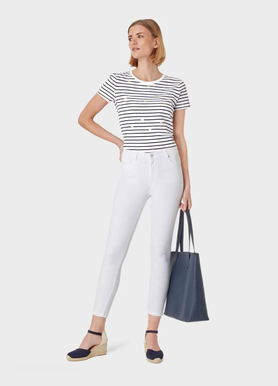 Striped t-shirt in black and white paired with white skinny slim fit jeans, espadrille wedges in black with an ankle strap detail and a black leather tote bag, ideal as a smart casual outfit. Hobbs.