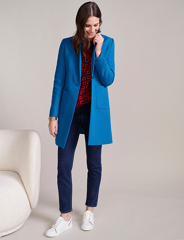 Blue Coat Over Dark Blue Skinny Jeans ans Printed red Blouse