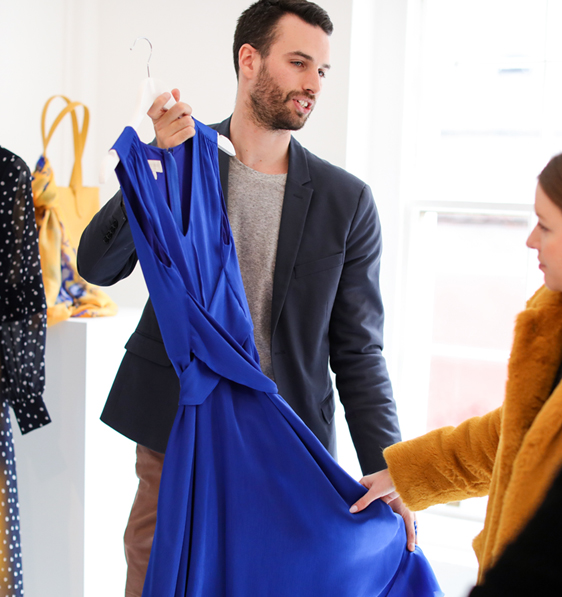 Senior Digital Marketing and PR manager, Algy Belmont shows a hobbs cobalt blue dress at an event