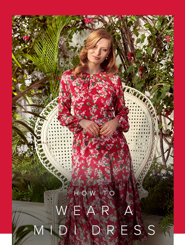 Photographed next to a contemporary armchair, model wears a printed fit and flare linen dress.