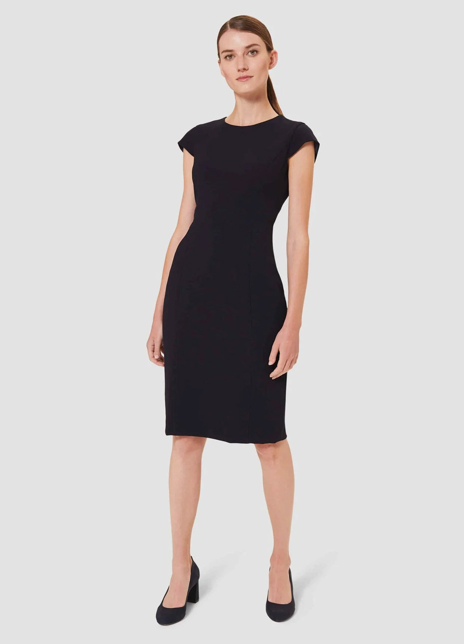 Black shift dress worn with block heeled court shoes in black, by Hobbs.