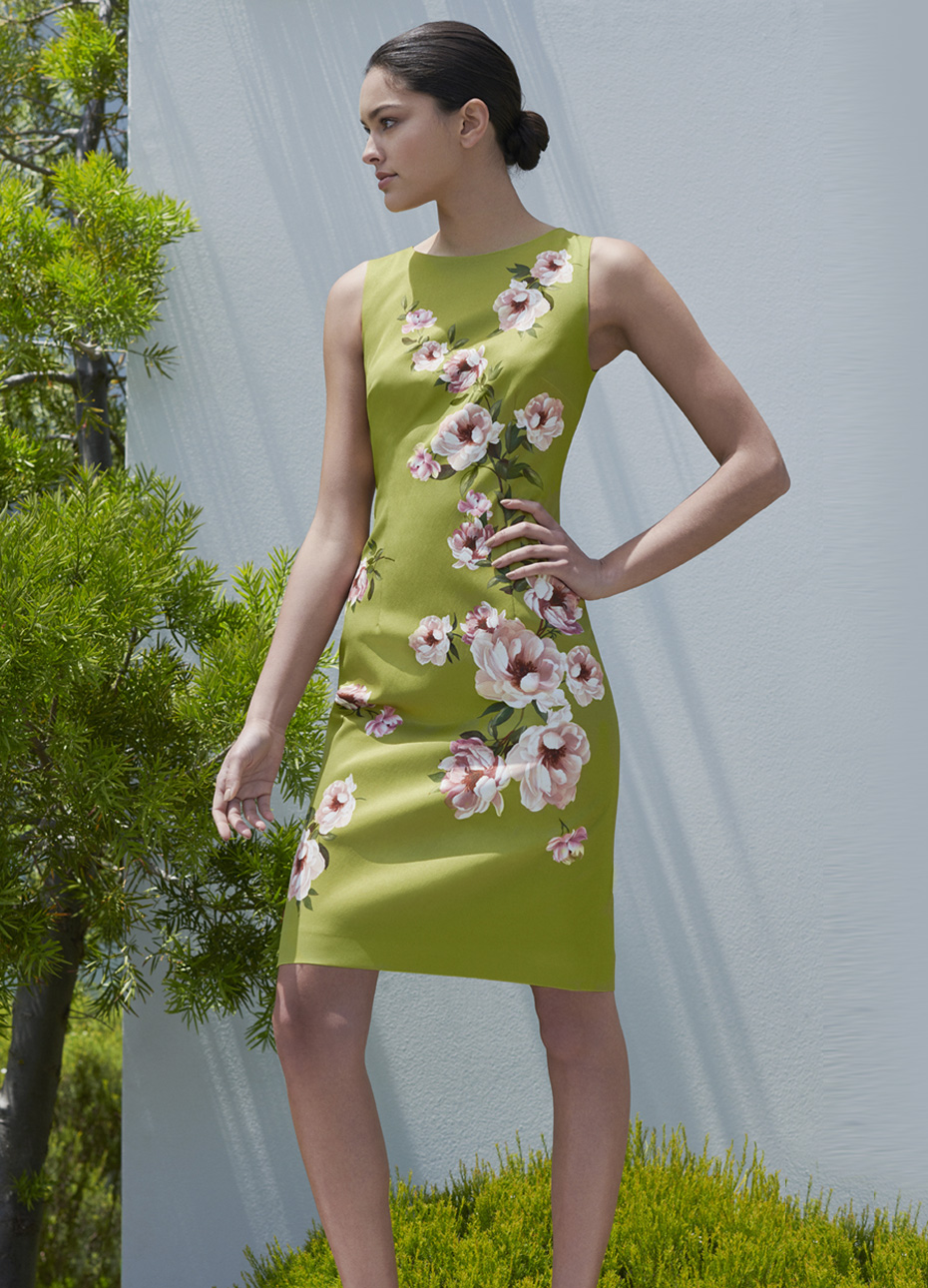 Green shift dress with a pink floral pattern worn with nude court shoes by Hobbs.