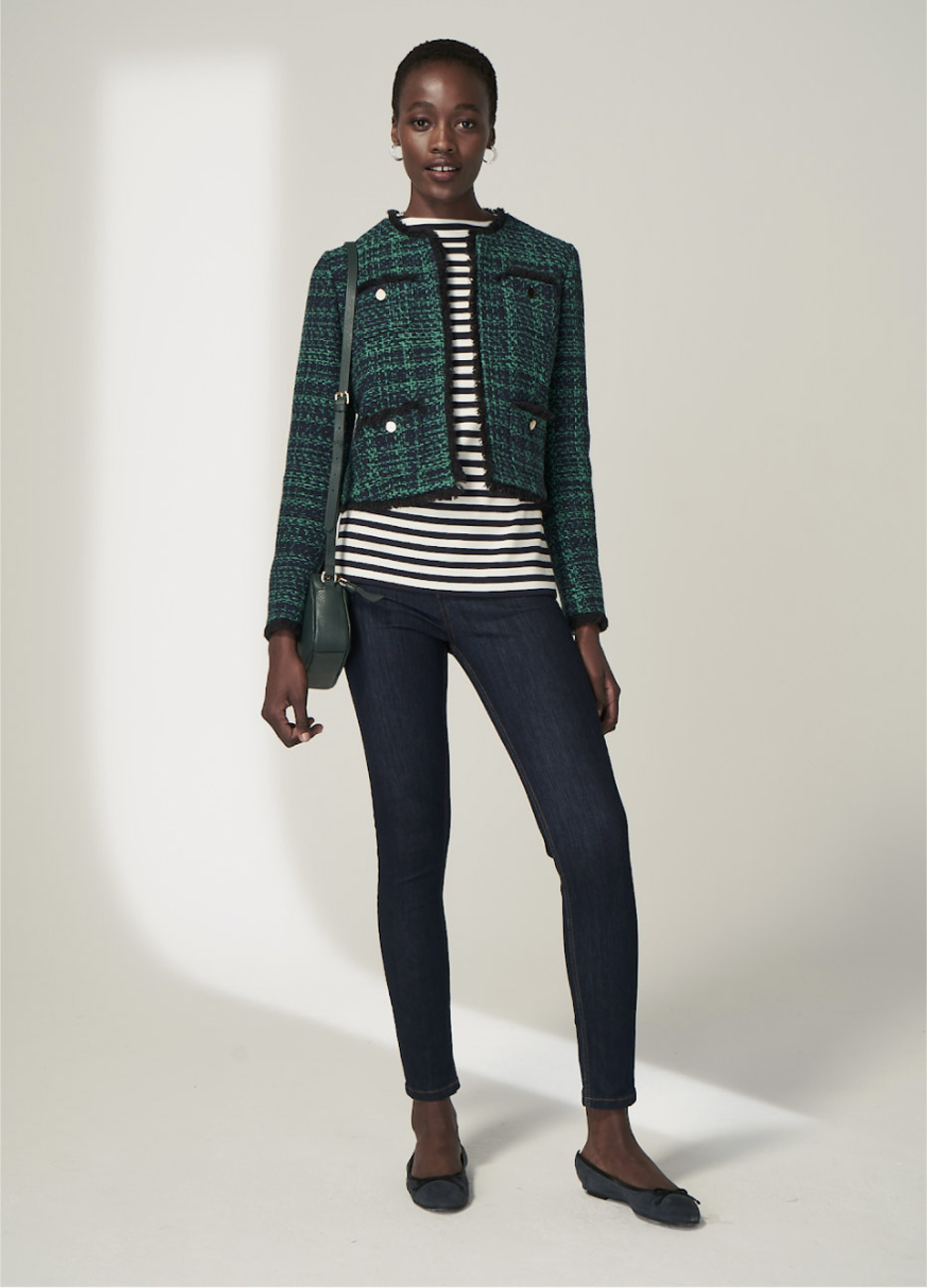 Hobbs model wearing a tweed jacket in green over a striped top, styled with black skinny jeans and black ballerina pumps.