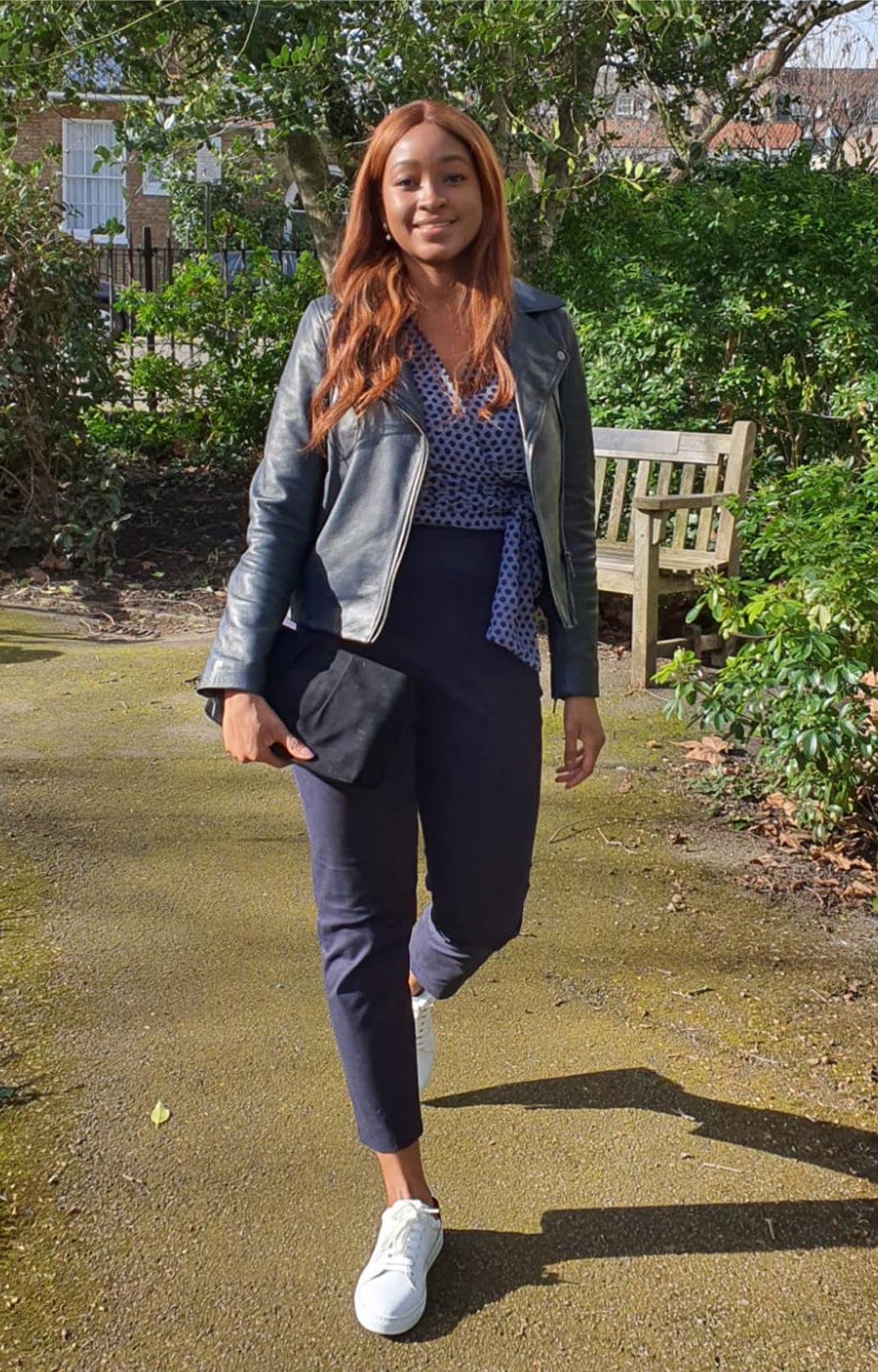 Fashion blogger @rufaro_styling photographed on a walk wearing Hobbs Tania navy leather jacket, Elizabeth Blouse and Yasmin capri trousers.