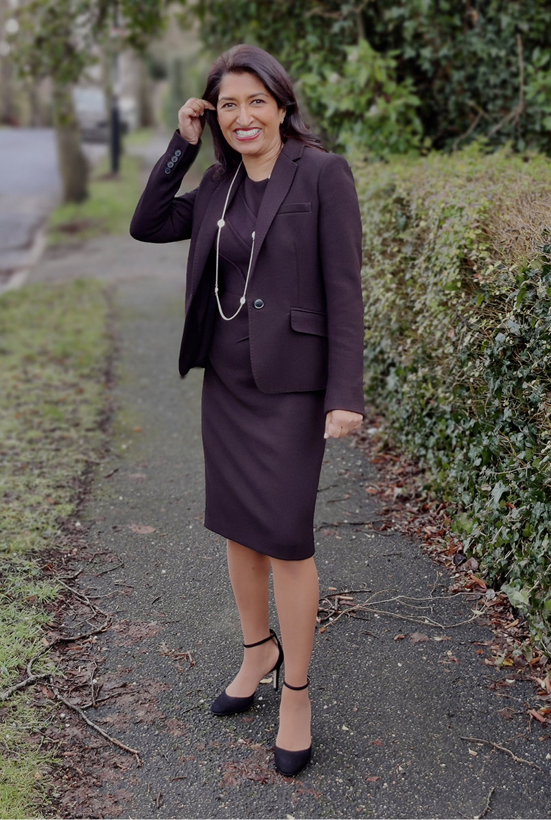 Photographed walking along her street, fashion blogger Monika Mandal wears Hobbs petite Ophelia black jacket and matching dress.