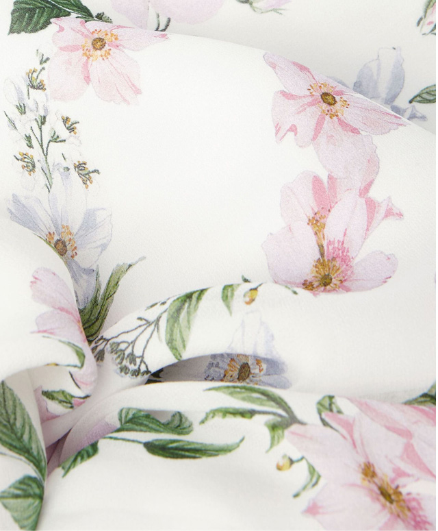 Close-up of rose floral print fabric.