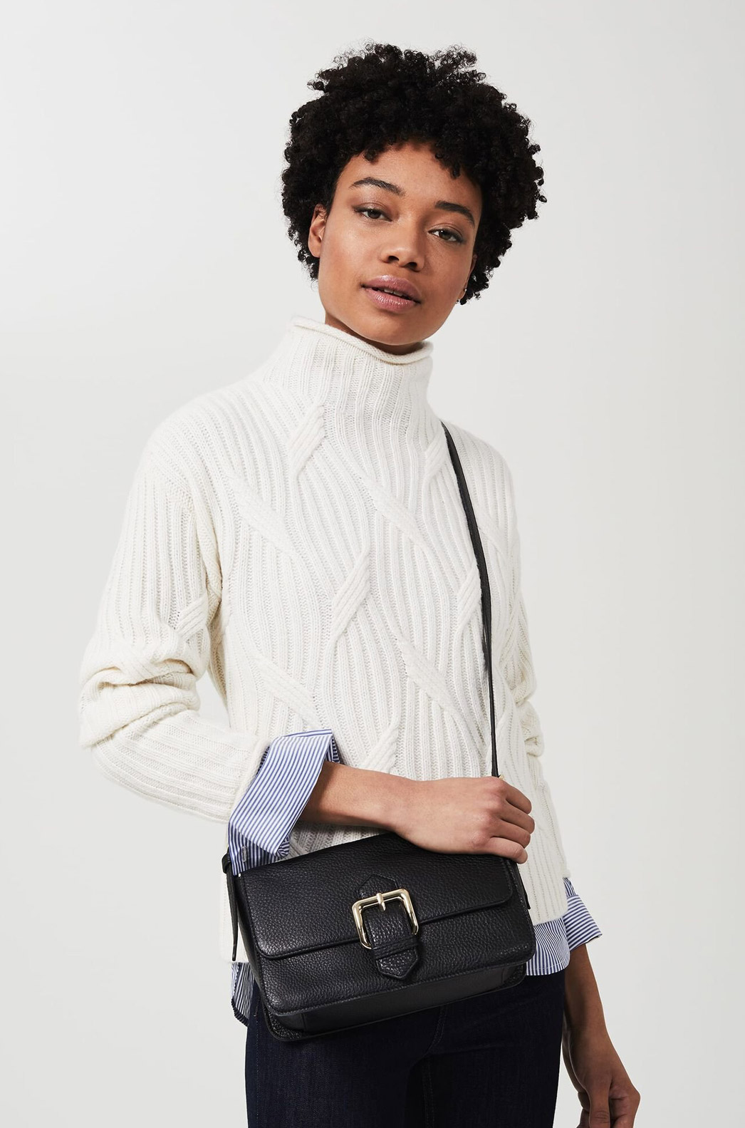 Model photographed wearing Hobbs black leather Selbourne crossbody bag.