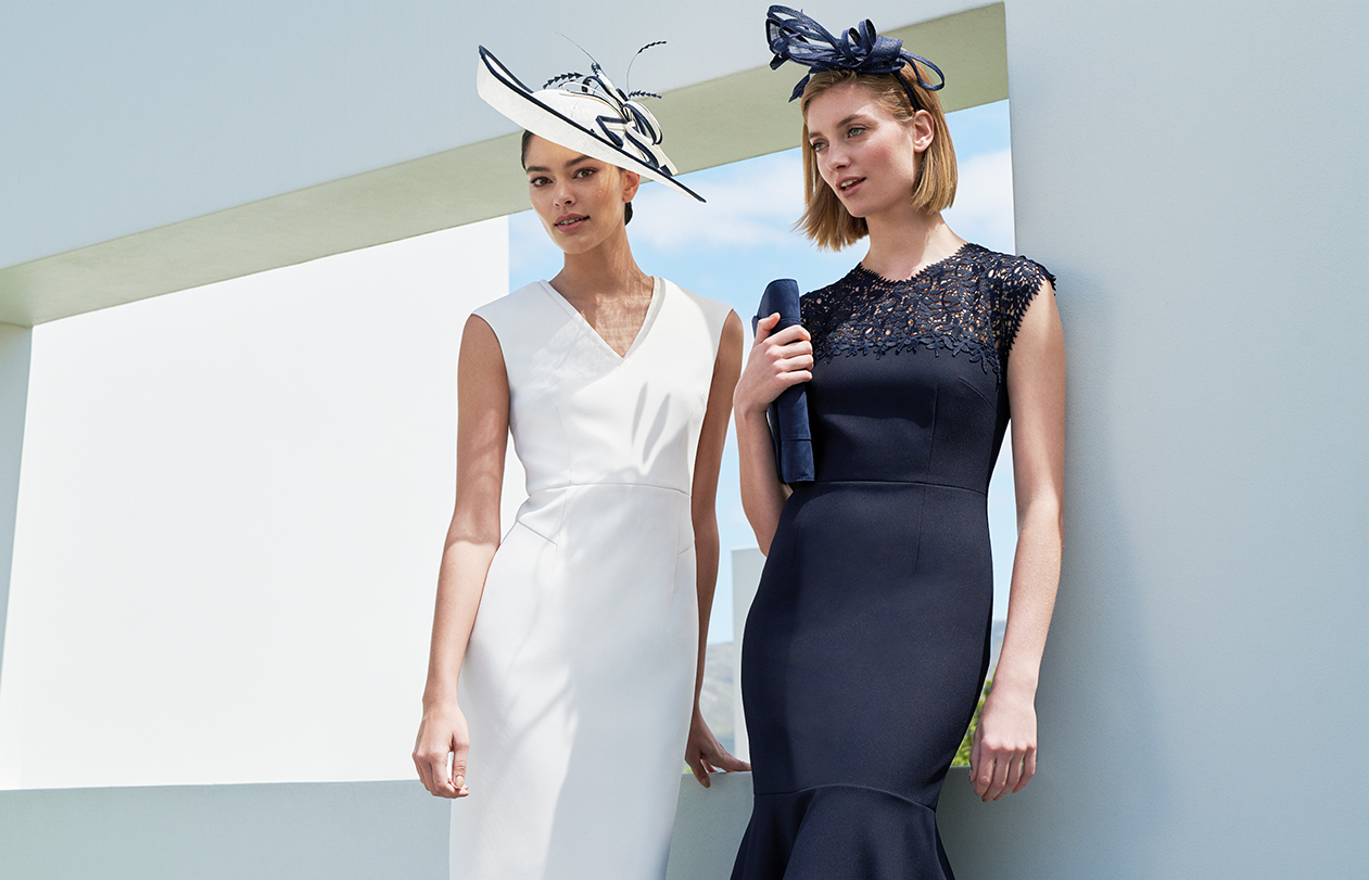 White occasion dress and navy occasion dress with matching fascinators by Hobbs.