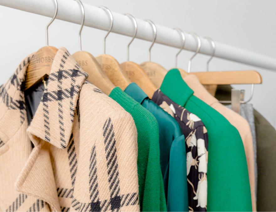 Image of rail showing women's autumn clothing.