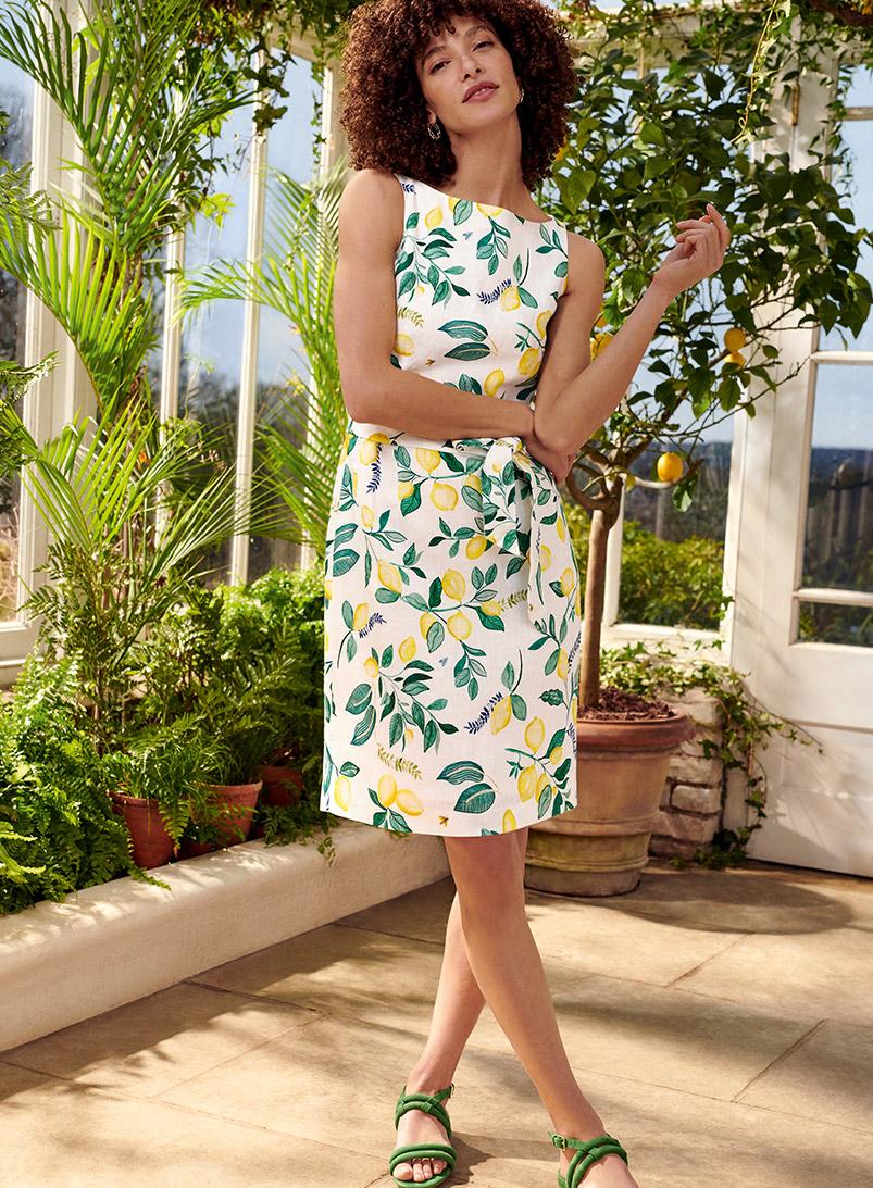 Model wearing a Hobbs Lemon print dress.
