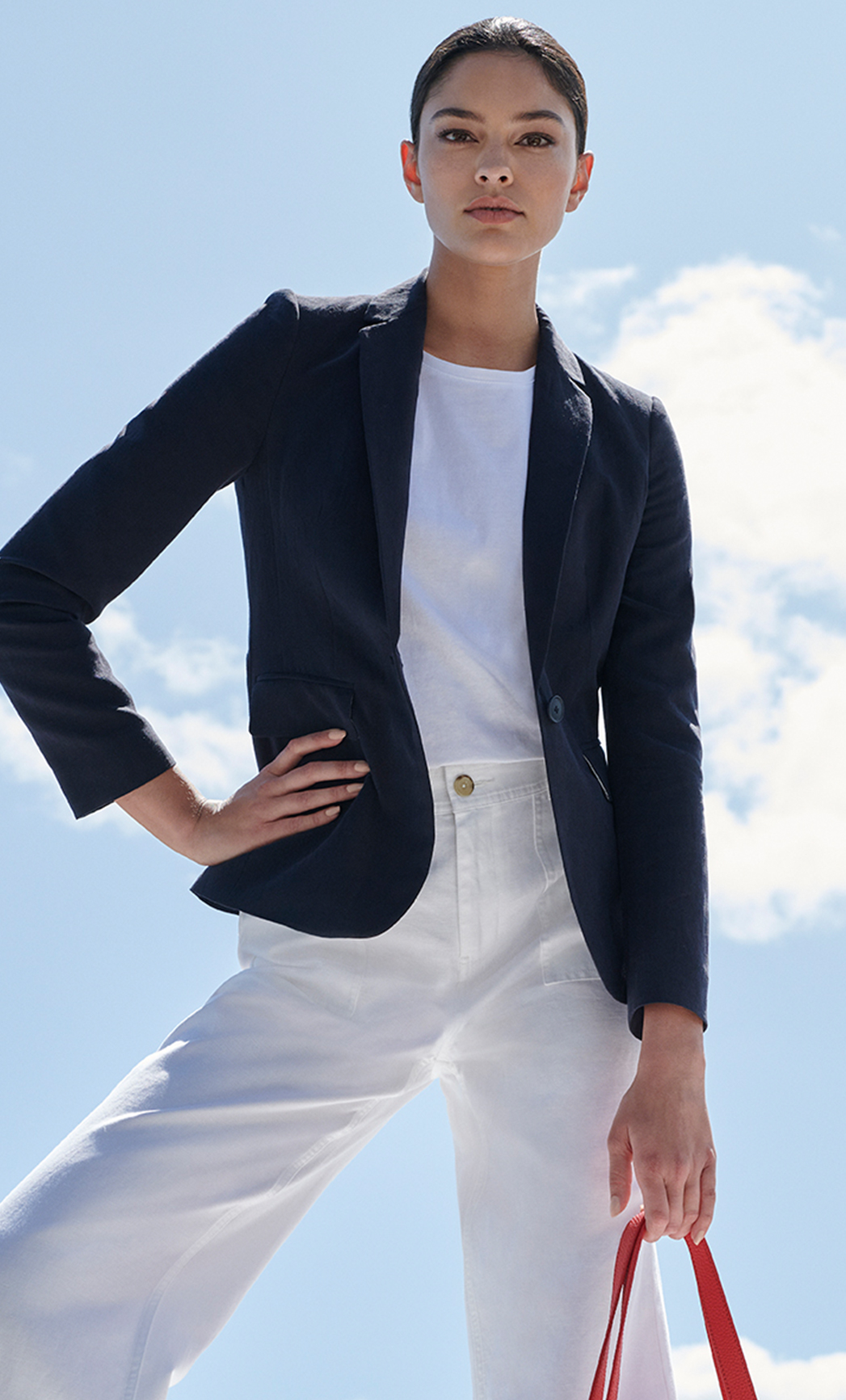 Light layers with navy blazer, with white t shirt and white jeans