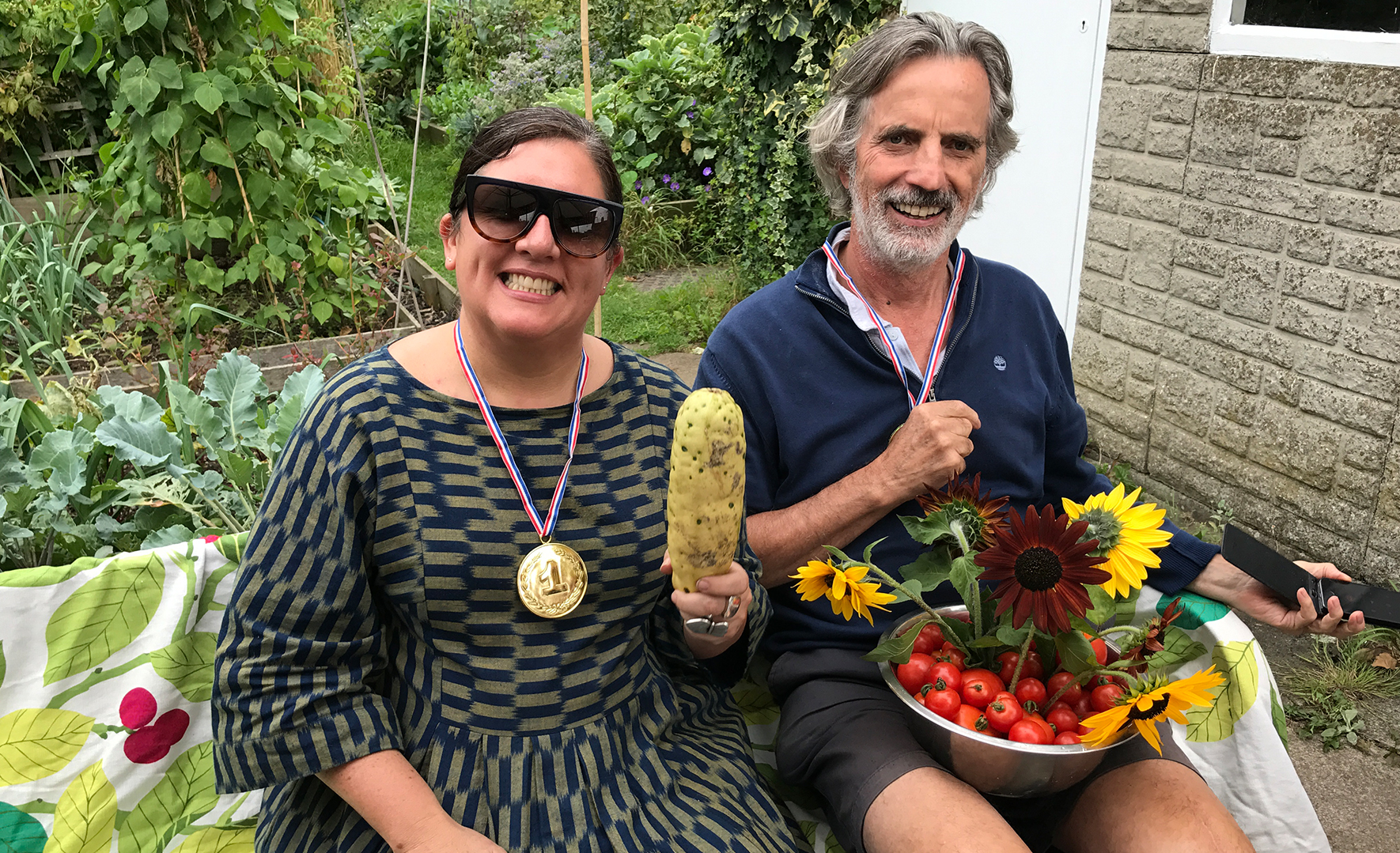 Rosarie and a friend show off the fruits of their hard work in thre allotments