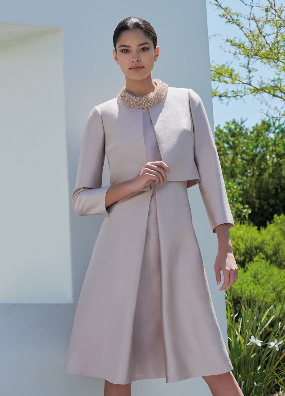Pink occasion dress with embellished collar detail, paired with a long sleeved matching jacket by Hobbs.
