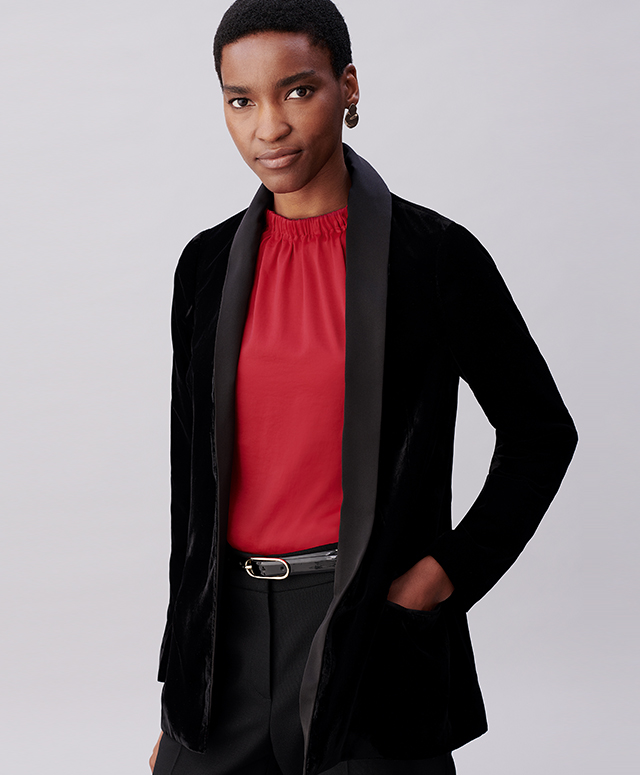 Model photographed wearing a black velvet jacket over a metallic thread shirt dress.
