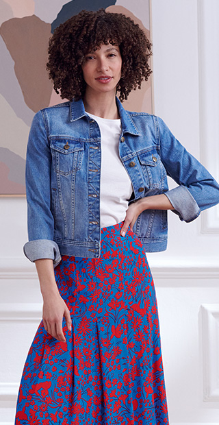 Blue Denim Jacket Over White T-Shirt and Printed Skirt