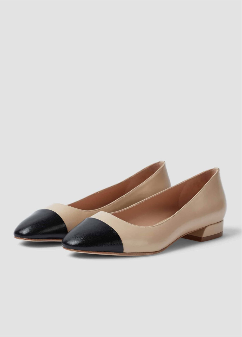 Hobbs heeled ballerina flats in nude with a black toe cap design.
