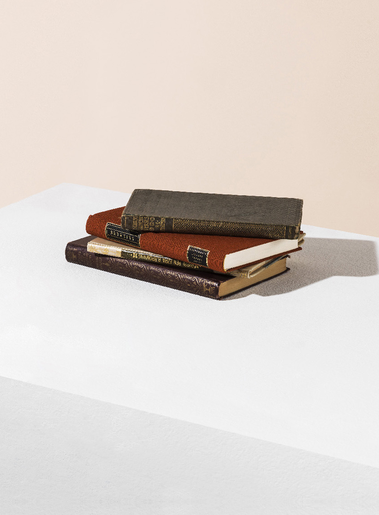 Artful stack of leather bound books