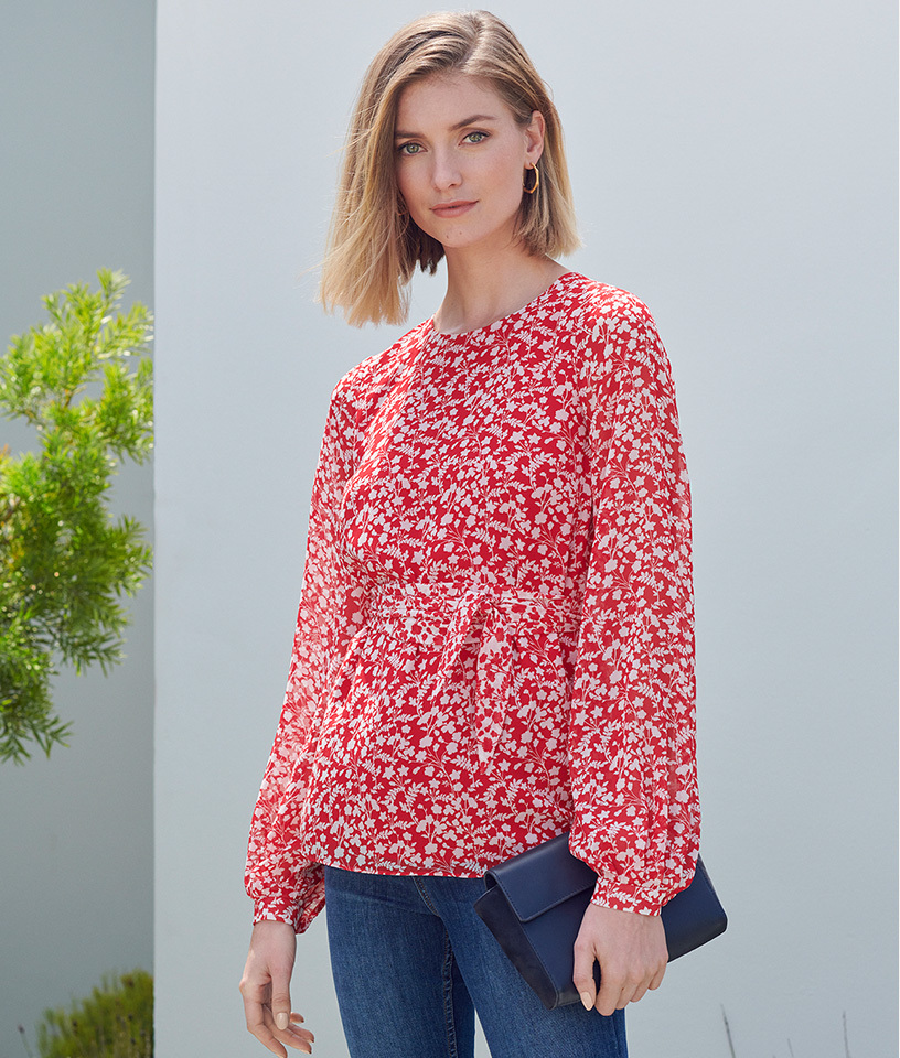 Red blouse with white floral print