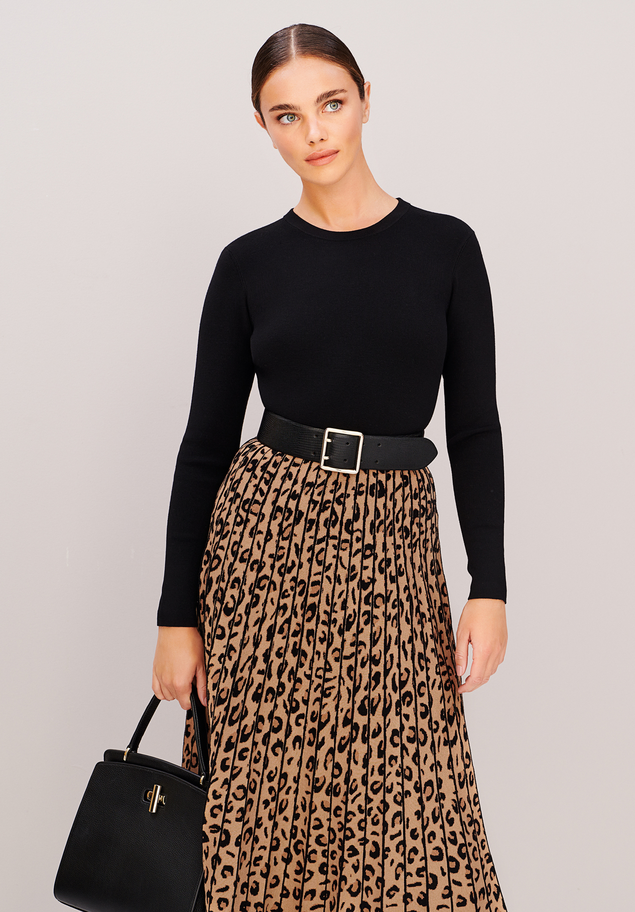 Model wears a knitted leopard print dress with a belt from Hobbs.