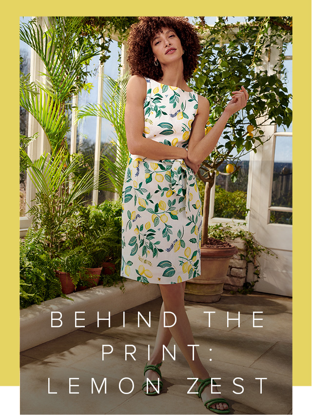 Model photographed in a conservatory wearing Hobbs lemon print summer dress.