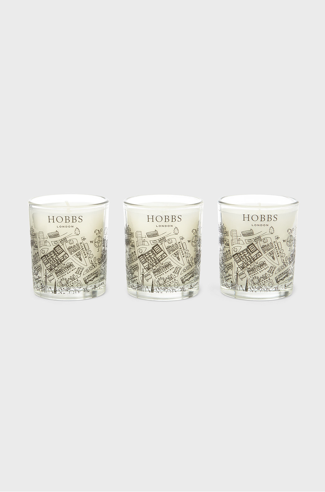 Set of three Hobbs candles presented in glass jars with illustrations of Hampstead.
