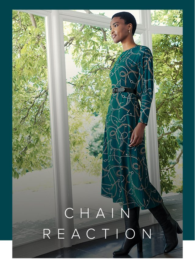 Hobbs Angela Green Chain Print Midi Dress styled with knee high leather boots