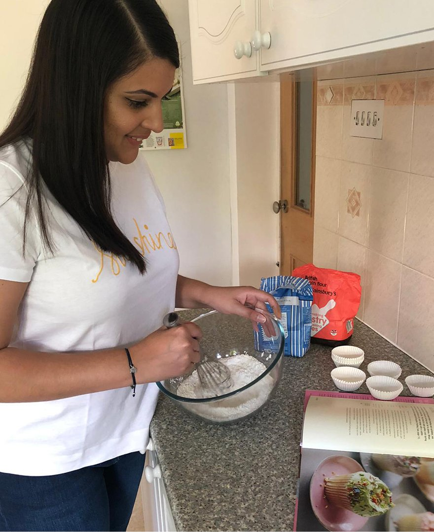 Priya bakes at home wearing the Hobbs sunshine t-shirt and gia sculpting jean