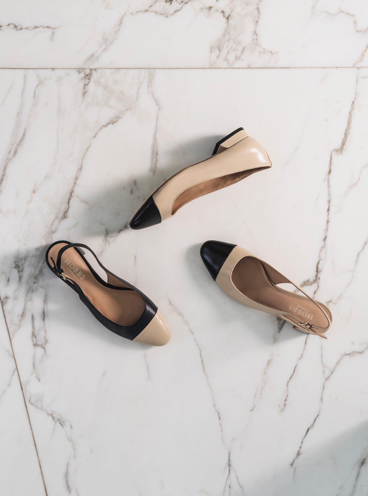 Hobbs women's flat shoes in nude and black.