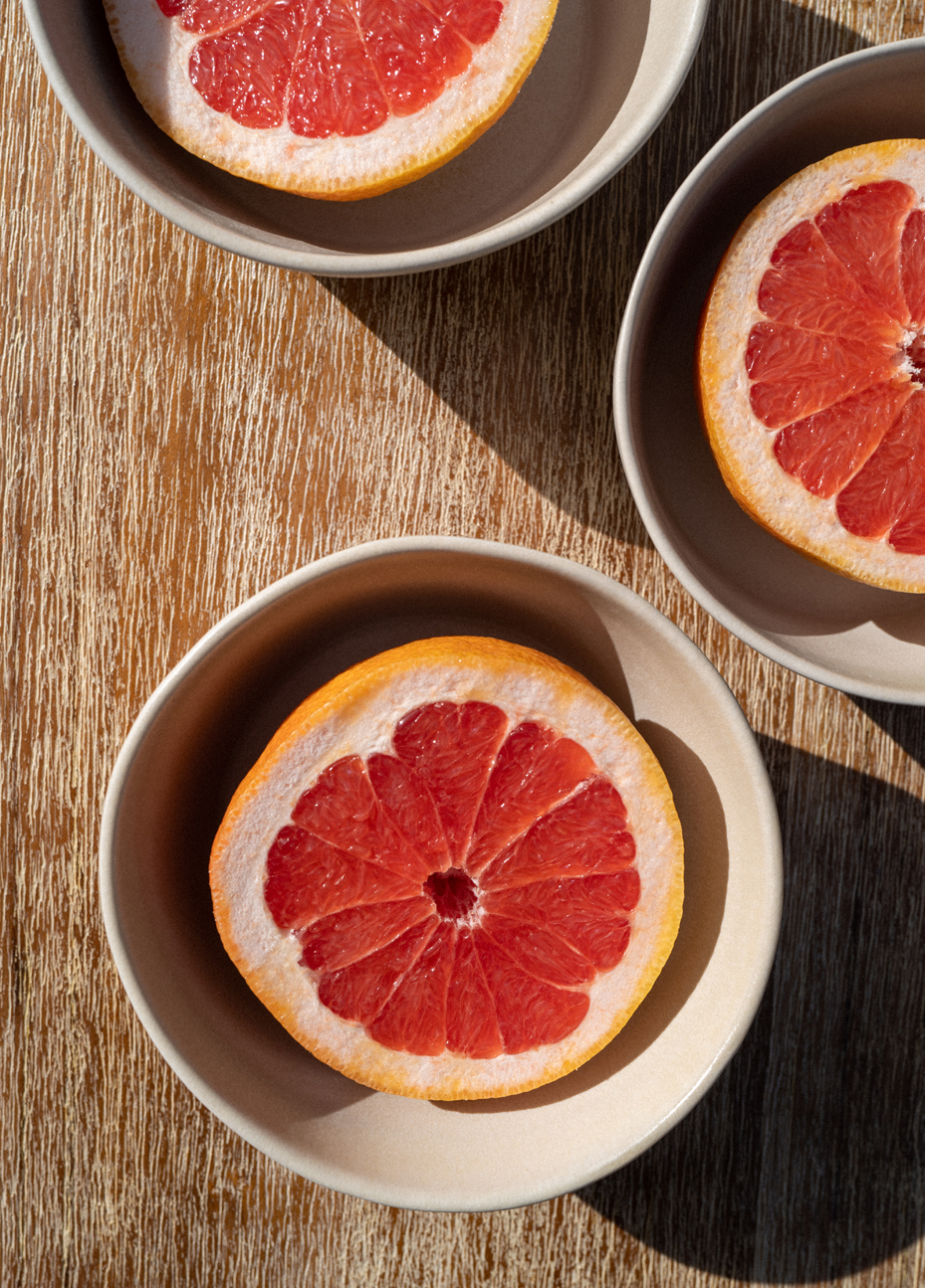 Photograph of sliced grapefruit in bowls, captured by photographer Charlotte Bland.