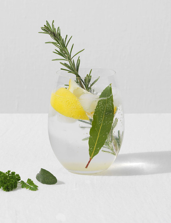 Glass of Gin with rosemary and lemon