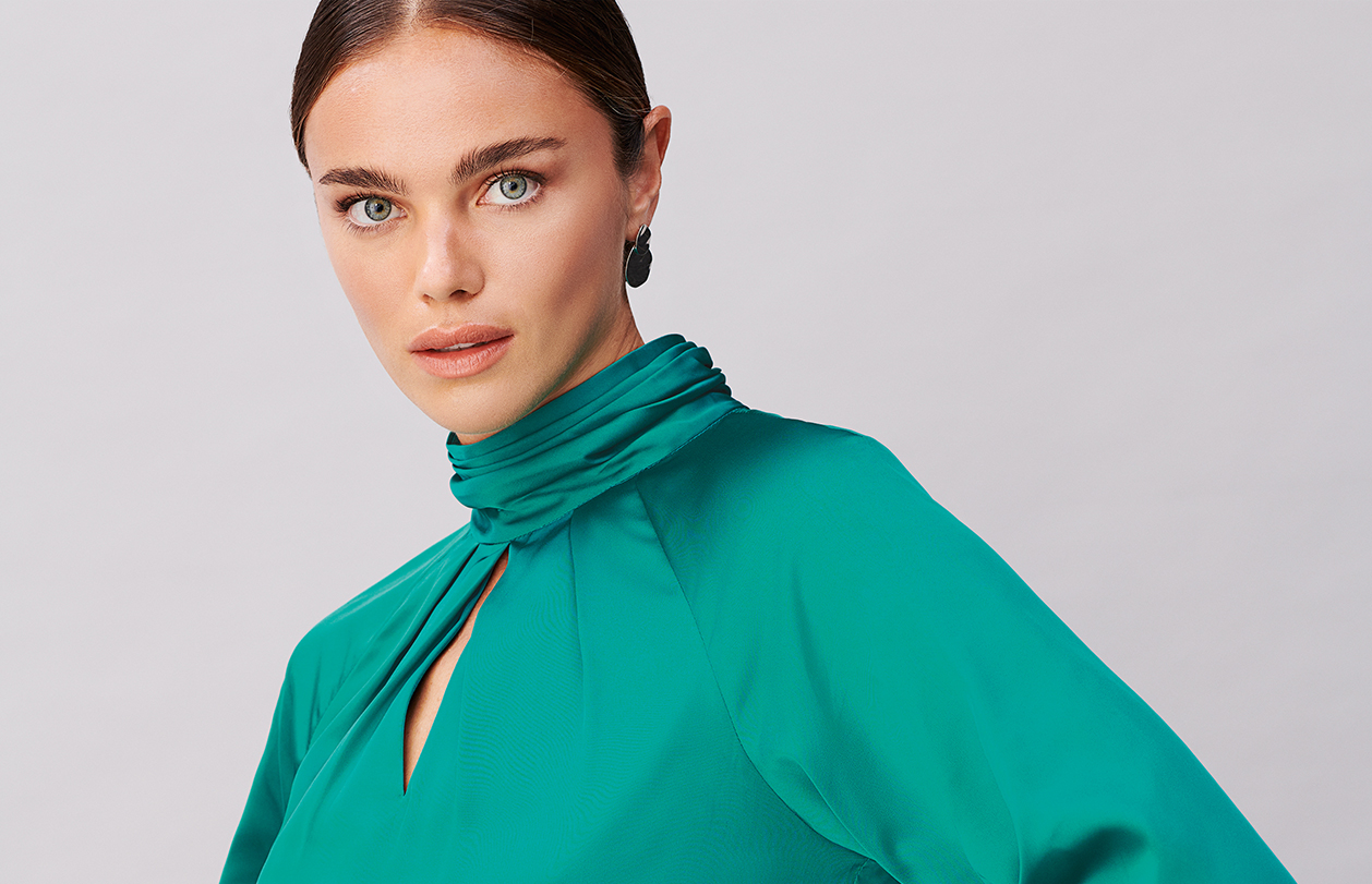 Model wears a satin blouse from Hobbs.