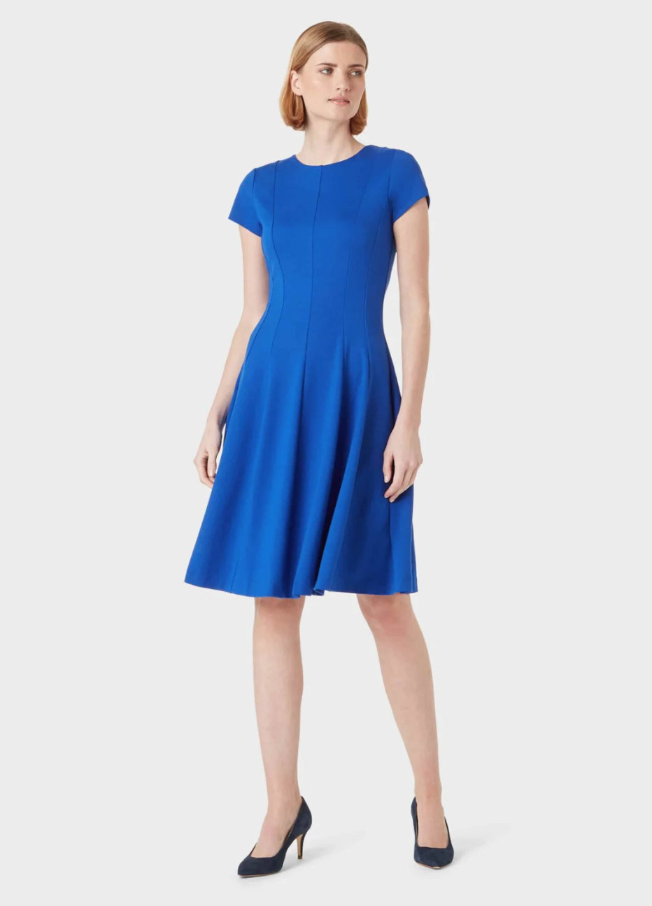 Blue fit and flare work dress with black court shoes by Hobbs.