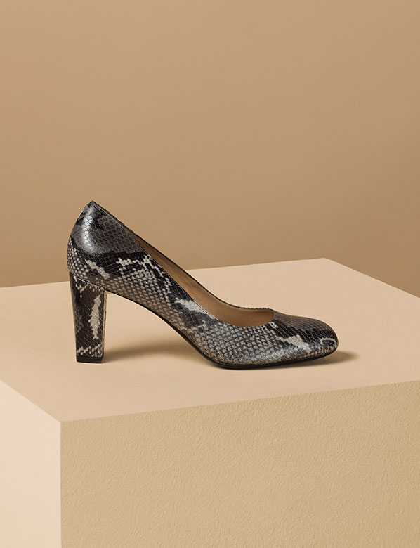 Snakeskin court shoe on plinth