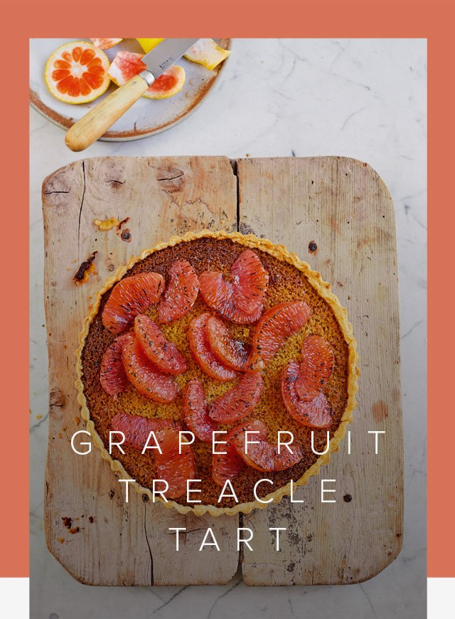 Prue Leith's Grapefruit Treacle Tart on a wooden board