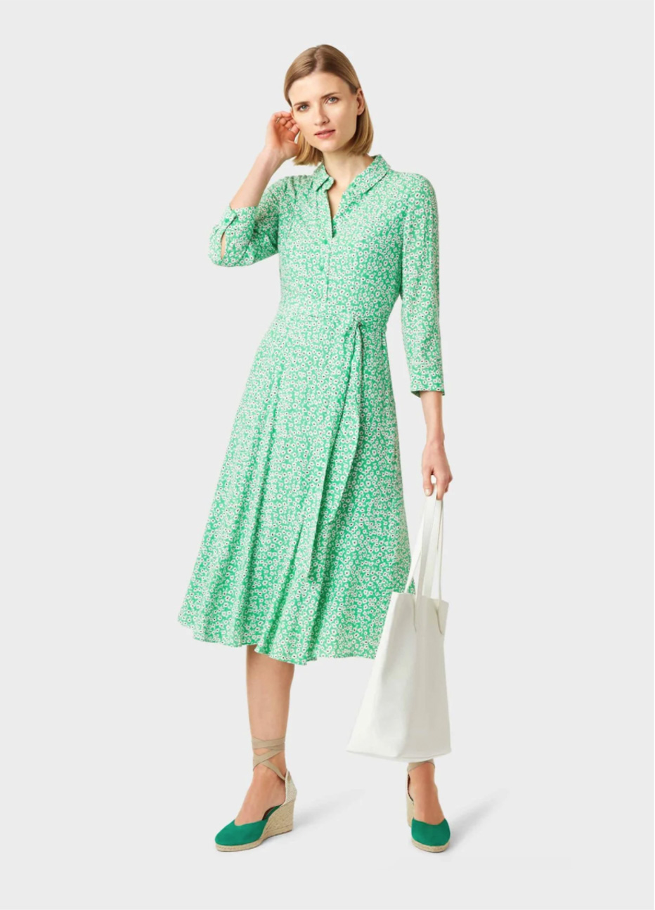 Mid-sleeved fit and flare shirt dress in green with a waist-tie detail paired with green wedge espadrilles with a white leather tote bag, a smart casual look for women by Hobbs.