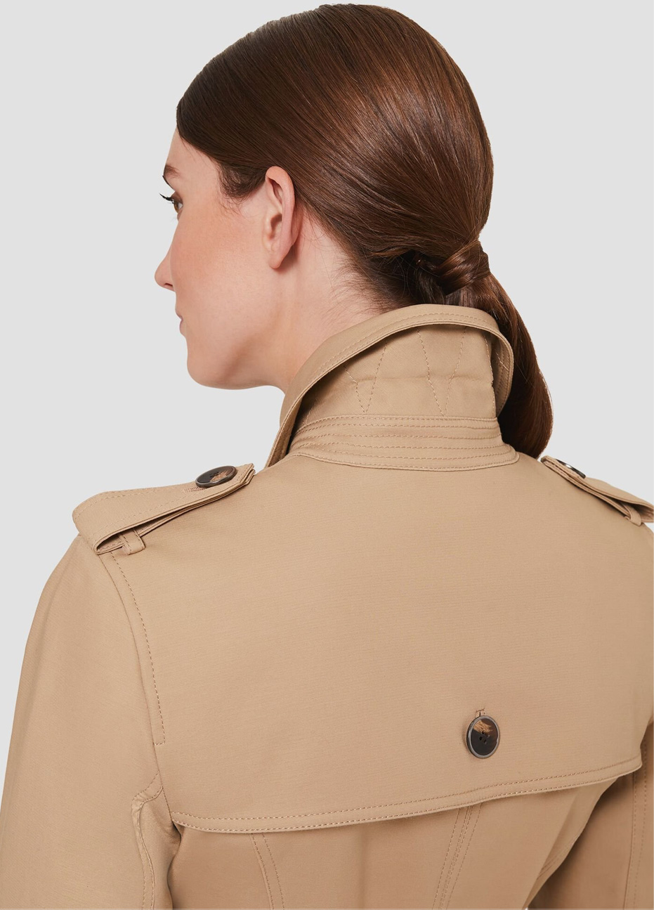 The back of a Hobbs model wearing a beige trench coat.