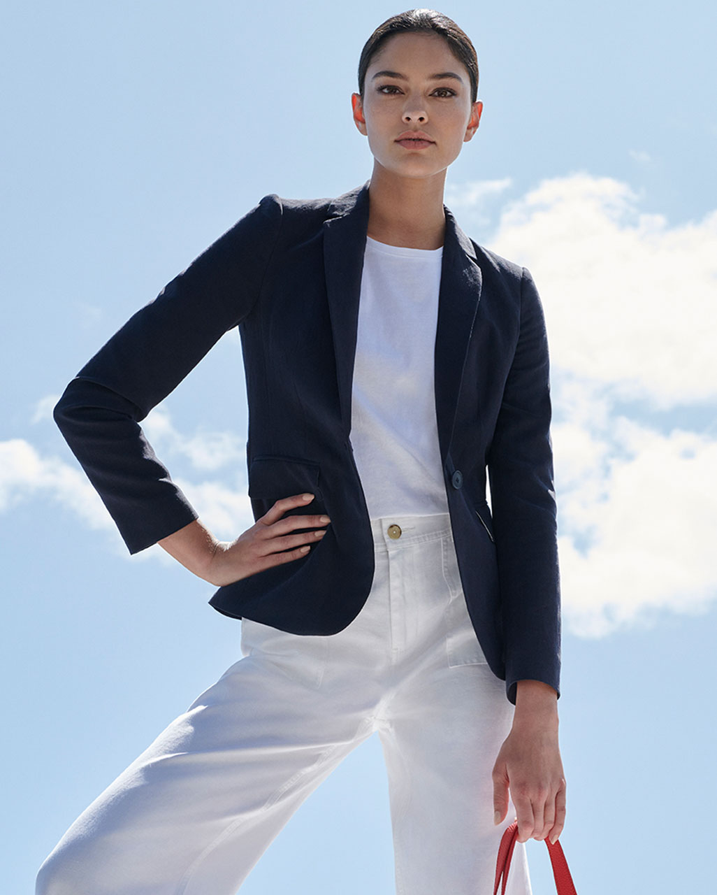 Navy linen jacket, white top, white linen trousers