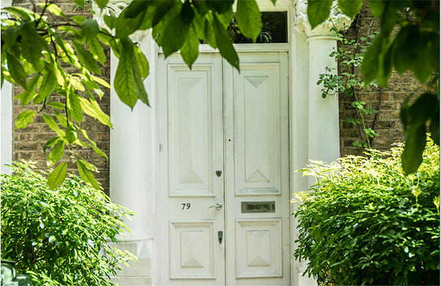 The white double front door of our copywriter, Hannah's London home.