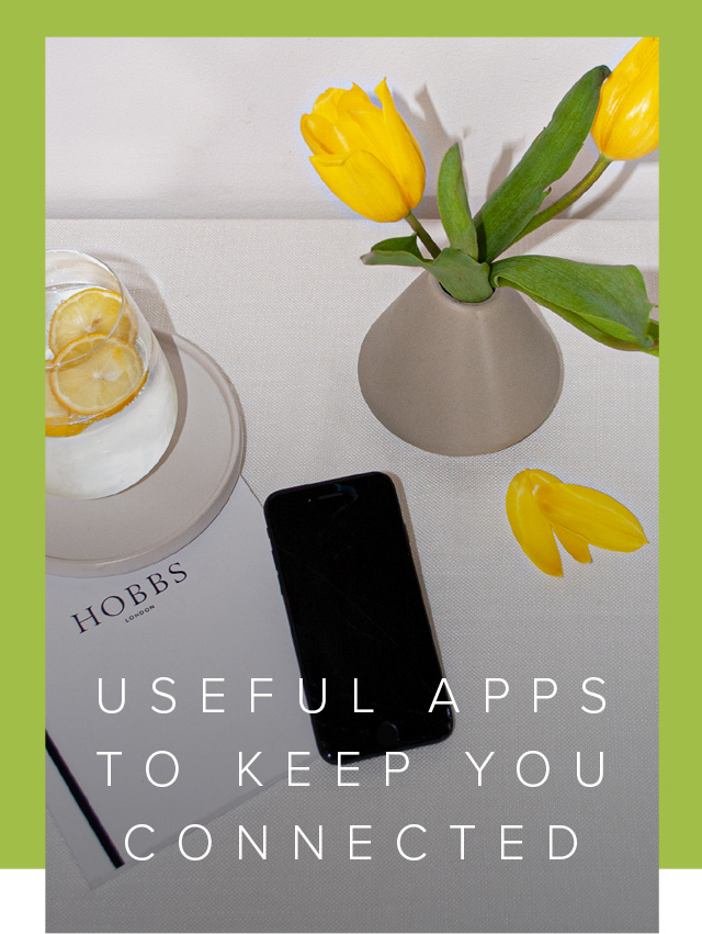 Keep connected still life with mobile phone, notebook and yellow tulips