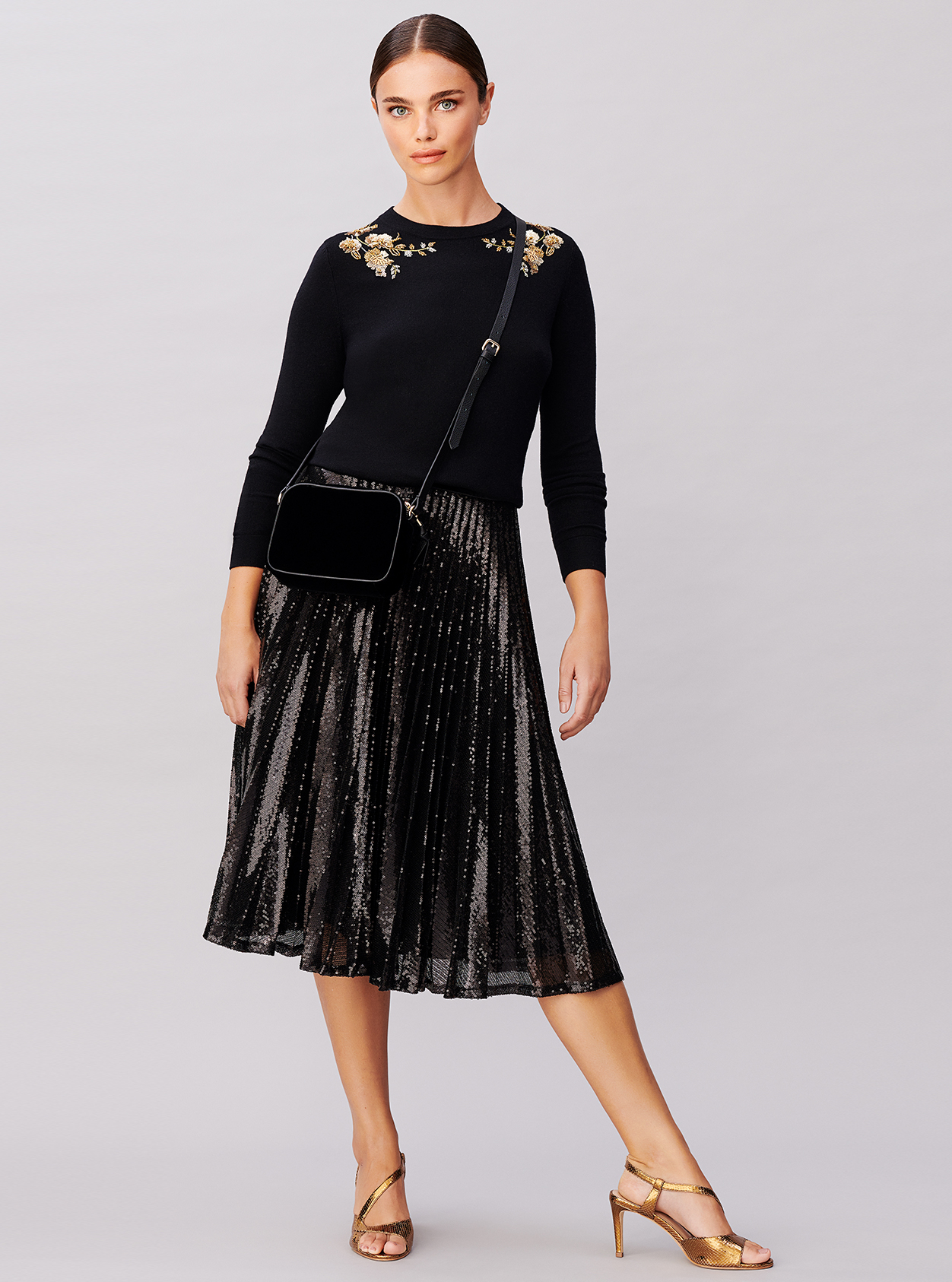 Sequin midi skirt worn with an embellished jumper, velvet crossbody bag and metallic heeled sandals from Hobbs.