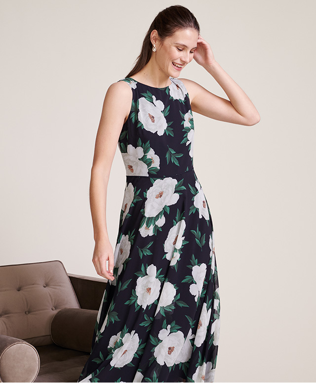 Model photographed wearing Hobbs Carly dress with a peony floral print.