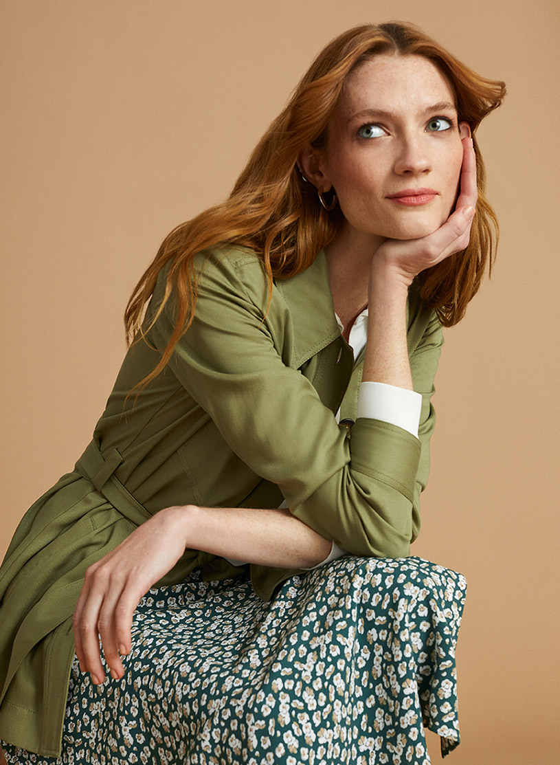 Green Jacket and Skirt Sitting Down Outfit