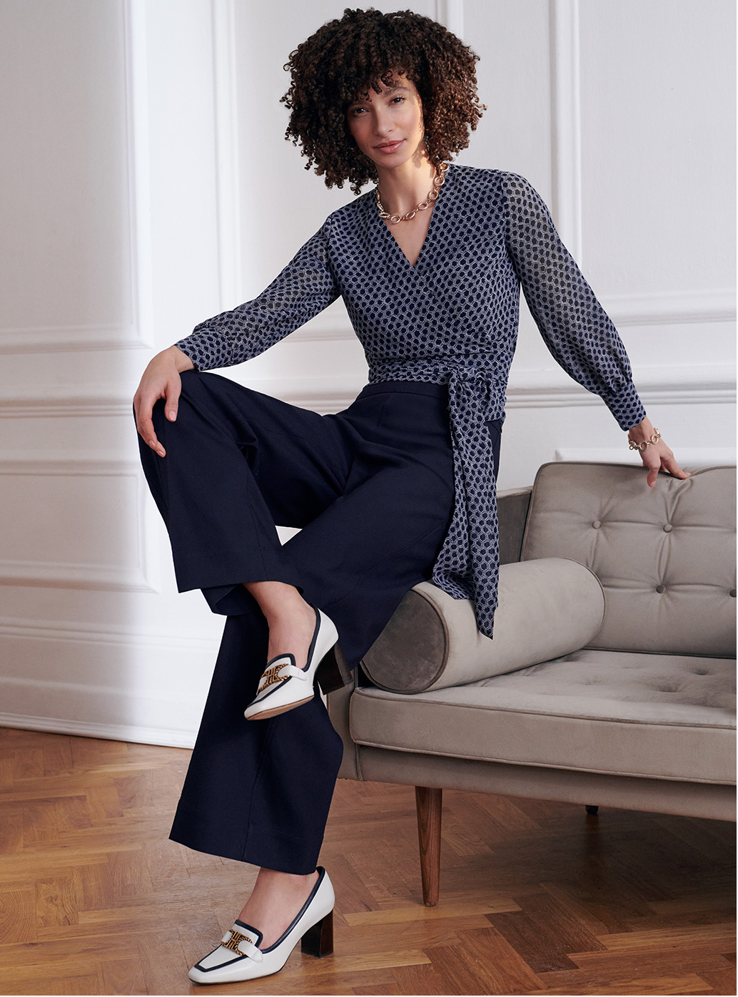 Model wears Hobbs white and navy court shoes.