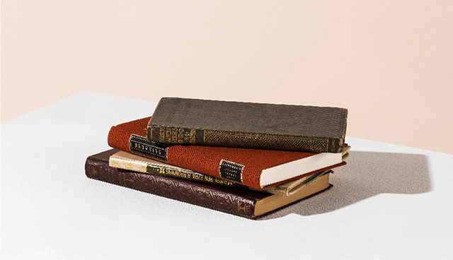 A pile of leather bound books
