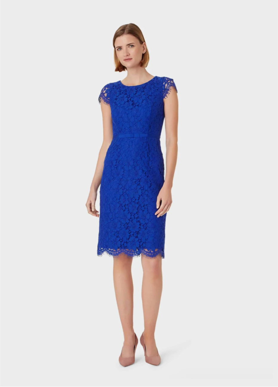 Lace shift dress in blue worn with nude court shoes by Hobbs.