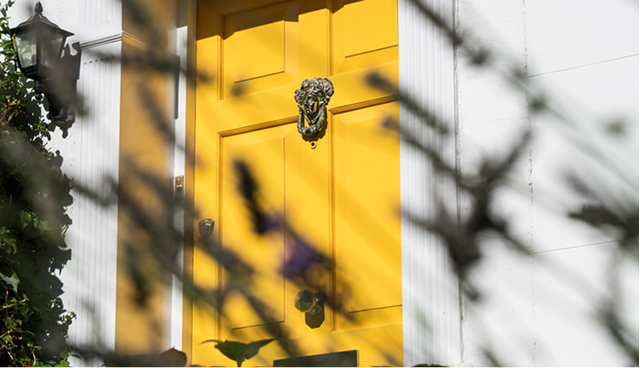A yellow london front door to Hobbs Senior Trading manager's hobbs at home