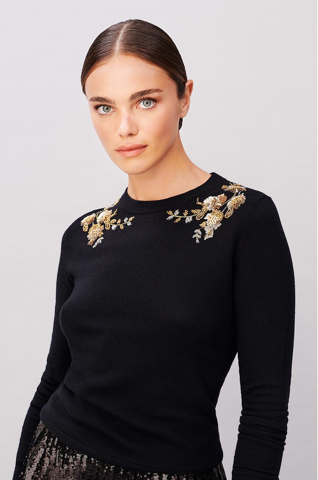 Model wears an embroidered jumper from Hobbs.